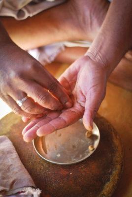Making sandalwood paste by hand. Photo (cc) Harsha K R